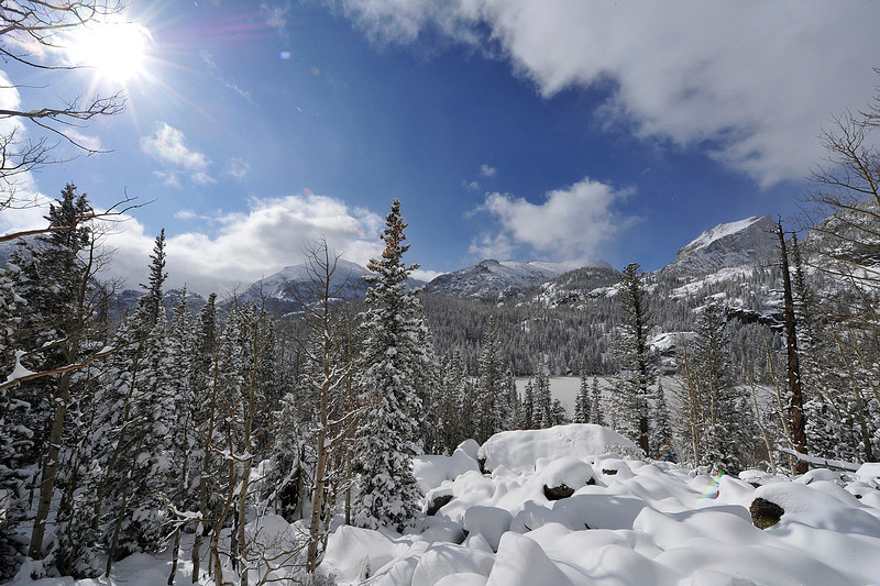 Walt Hester | Trail Gazette<br /> Clouds part and sunshine shimmers on new snow around Bear Lake on Wednesday. The fast-moving storm dumped another 9 inches of snow in the area that saw 17 last week.