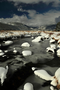 Walt Hester | Trail Gazette Snow decorates and ice forms along the Big Thompson River in Moraine Park on Wednesday. More snow is in the weekend forcast