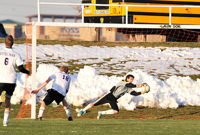 Walt Hester | Trail Gazette Bobcats' goalkeeper Josh Hays dives to make a save in their playoff game on Friday. Hays was outstanding in goal, keeping the 'Cats close throughout.