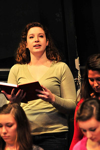 "Walt Hester | Trail Gazette Tamsen Glaser of the University of Western Michigan's Cantus Femina choir reads entries from the diary of Anne Frank at Estes Park High School on Thursday. The all-women's choir performed ""Now I Become Myself,"" a piece based on the famous diary."