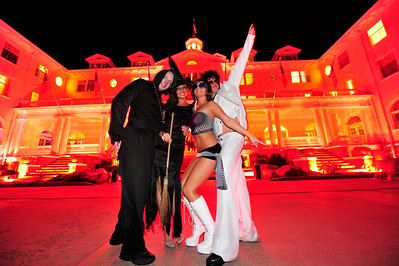 Walt Hester | Trail Gazette Ryan Warman of Ney York, Kindra Francis, Joclin Somonson and Kevin Paul of Denver pose in front of the reddened Stanley Hotel before the Shining Ball on Saturday. The event attracted gouls, swans, witches and pirates from far and wide to the birthplace of the horror classic.
