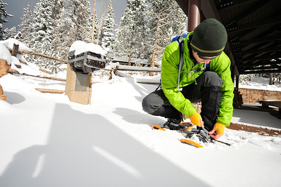 Walt Hester | Trail Gazette Aaron Blanding of Boulder straps on his snowshoes at Bear Lake on Wednesday. The second storm in as many Wednesdays dropped nine inches of new snow on top of what remained of the 16 inches that fell last week.