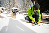 Walt Hester   Trail Gazette<br /> Aaron Blanding of Boulder straps on his snowshoes at Bear Lake on Wednesday. The second storm in as many Wednesdays dropped nine inches of new snow on top of what remained of the 16 inches that fell last week.