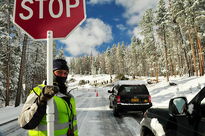 Walt Hester | Trail Gazette Traffic stops along Bear Lake Road for beetle kill work on Wednesday. The park also hopes to perform some slash pile burning after Wednesday's snow.