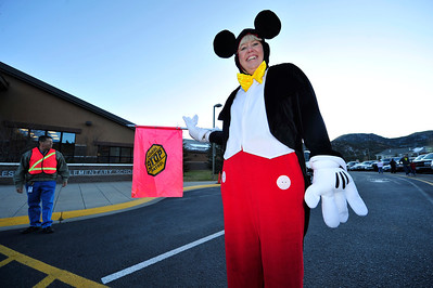 Walt Hester | Trail Gazette Sandee Life directs traffic at the Estes Park Elementary School on Tuesday. Teachers and children all enjoyed the day at the school.