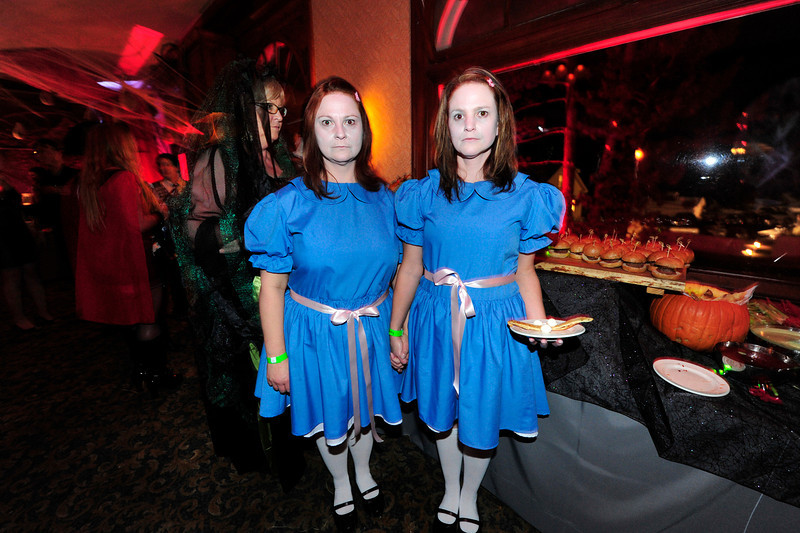 "Walt Hester | Trail Gazette<br /> Denise and Lisa Froehlich are the twins from the book and movie ""The Shining"" at the Stanley Hotel's Halloween ball on Saturday. The pair won one of several catagories in the ball's costume contest with their unnerving depiction."