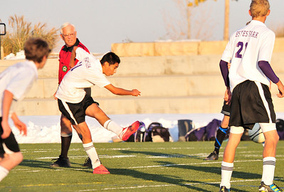 Walt Hester | Trail Gazette Luis Ayala takes a shot against Lutheran on Friday. Ayala scored the Bobcats' lone goal.