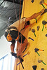 Walt Hester | Trail Gazette<br /> Steve Fragleasso tries to maintain balance in an awkward position while placing his feet. The tape on the wall guides climbers to place hands and feet.