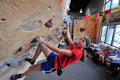 Walt Hester | Trail Gazette Kate Hageman, 13, of Golden works her way up a bouldering rout on Saturday. The tournament offered challenges for many different levels of skill and experience, from easy, jug-handled inclines to smearing, overhanging routs.
