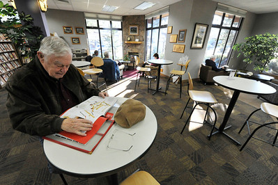 Walt Hester | Trail Gazette Gary Johnson of Estes Park enjoys a magazine at the Estes Valley Public Library on Wednesday. The library's reading area offers a refuge from coming winter weather.