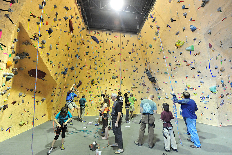 Walt Hester   Trail Gazette<br /> The routs of the Estes Park Mountain Shop make a colorful confetti stuck to the walls on Saturday. The shop hosted this weekend's Hold-On climbing tournament and festival.