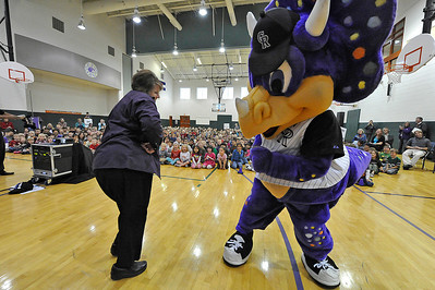 Walt Hester | Trail Gazette Robin Calvin of the Estes Park Elementary School dances with the Colorado Rockies mascot, Dinger, at the Rockies Ralley event at the school on Monday. The event was to promote good life choices for students.