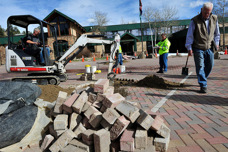 Walt Hester | Trail Gazette<br /> Contractors and officials begin work on the paving stones on MacGregor Avenue on Friday. The town found many broken stones on the newly-paved stretch of road.