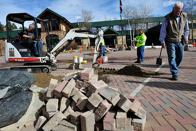 Walt Hester | Trail Gazette Contractors and officials begin work on the paving stones on MacGregor Avenue on Friday. The town found many broken stones on the newly-paved stretch of road.