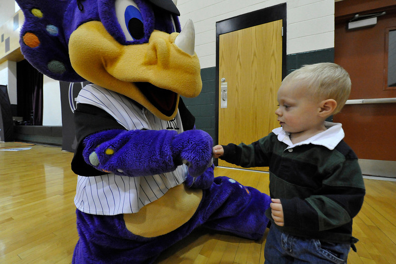 "Walt Hester | Trail Gazette<br /> Colorado Rockies mascot, Dinger, exchanges ""knuckles"" with 21-month-old fan Carter Gooch at the Estes Park Elementary School on Monday. Dinger made an appearence at the school on Monday to encourage kids to make good choices in life."