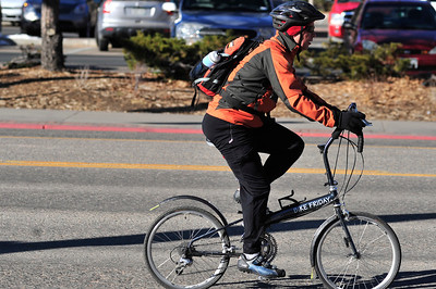 Walt Hester | Trail Gazette A well-bundled cyclist peddles up Elkhorn Avenue on a foldable bike on Wednesday. Dedicated cyclists find way to keep spinning, no matter what.