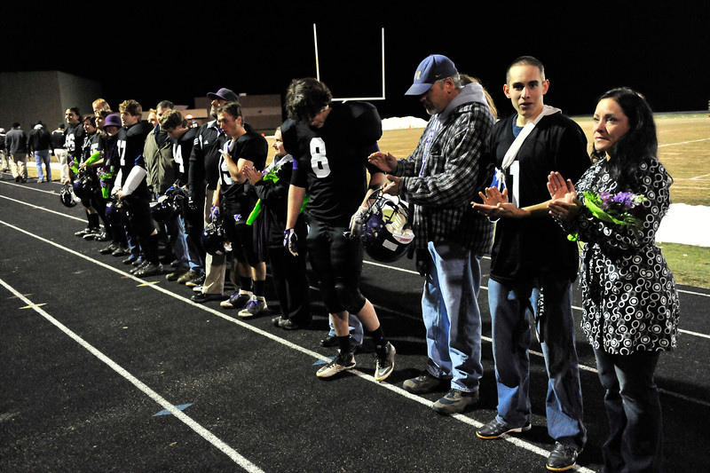 Walt Hester <br /> Bobcats' seniors stand for recognition before Friday's last home football game. The Estes Park seniors helped bring the football program a step farther toward respectability.