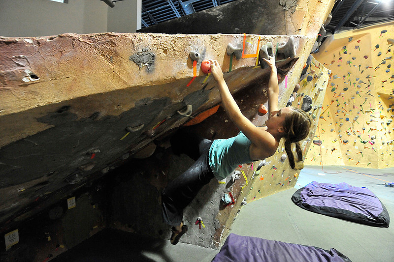 Walt Hester | Trail Gazette<br /> Darla Pienciak impresses friends by suceeding on a bouldering rout where others had failed. Climbing tends to favor light individuals, but it is hard to predict who will do well on individual routs.