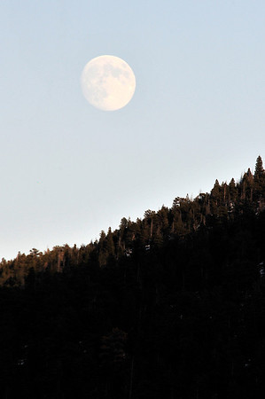 Walt Hester | Trail Gazette<br /> A big, nearly-full moon hangs in a cloudless sky on Tuesday evening. Clear or mostly clear blue sky should be the rule until Sunday, when another round of snow may come our way.