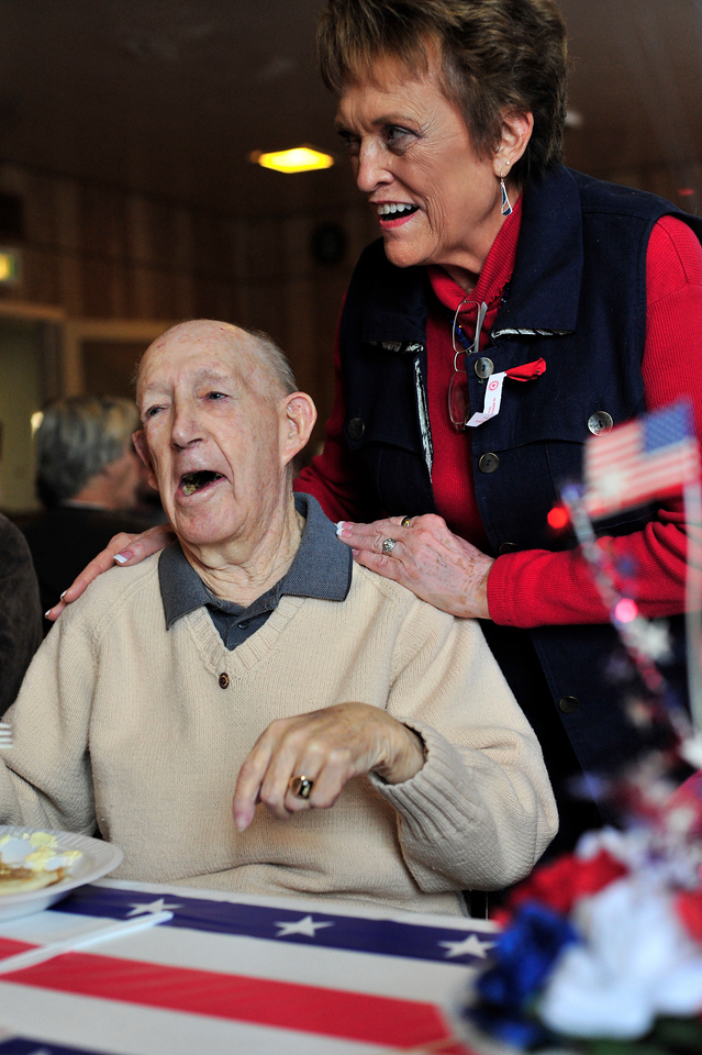 Walt Hester | Trail Gazette<br /> World War II veteran George Peck, enjoys a laugh with American Legion Post 119 Women's Auxillary President Sherry Rytting during the annual Veterans' Day breakfast at the legion hall on Thursday. Peck served as a Naval aviator in the Pacific, and was Post 119 Commander in 1951-'52, when the post baught the building they now occupy.