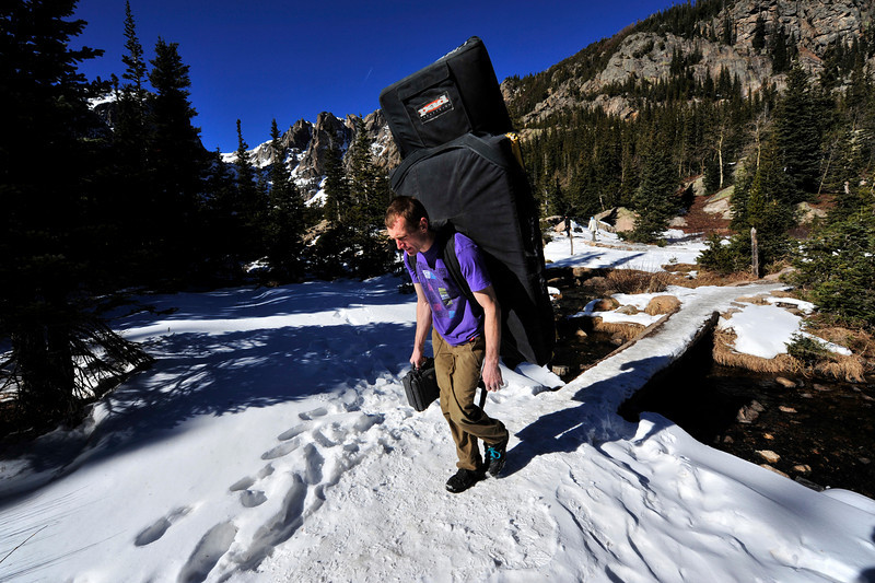 Walt Hester | Trail Gazette<br /> Jamie Emerson of Boulder hikes down below Dream Lake after a morning of bouldering on Monday. Several outdoor enthusiasts took advantage of what was expected to be the last warm day of the week, as cold and snow was forecasted for Tuesday.