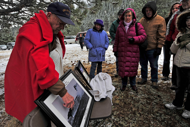 Walt Hester | Trail Gazette<br /> Bill Dye, left, recounts the sinking of the USS Lexington, on which he was serving at the time, after the annual Veterans' Day Sefvice ayt the Estes Valley Memorial Gardens on Thursday.