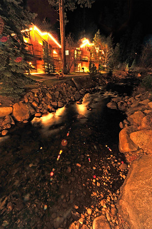Walt Hester | Trail Gazette<br /> Lights brighten lodges and skip across the Fall River on Tuesday.