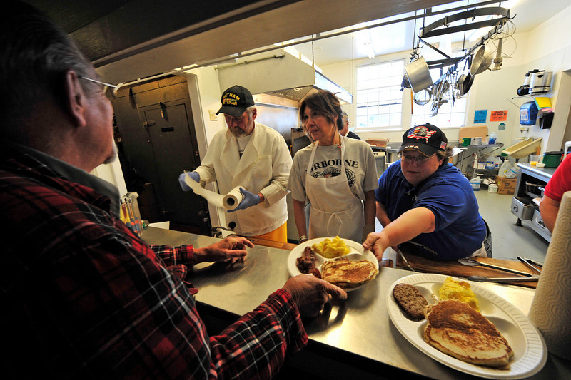 Walt Hester | Trail Gazette<br /> From left, Pete Anderson, Sherry Green and Sandy Mourning serve up pancakes, eggs, sausage, and if you want it, SOS during the annual Veterans' Day Breakfast at the American Legion Post 119 in Estes Park.