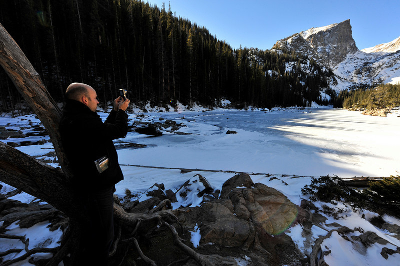 Walt Hester | Trail Gazette<br /> Reporter Thomas Straatemejer of the Netherlands photographs Dream Lake on Monday. The reporter was creating a story about fall hiking.