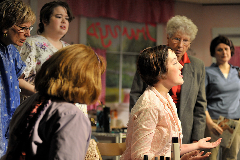 Walt Hester   Trail Gazette<br /> Shelby, played by Gracie Moreau, explains her bruises to the women at Truvy's salon. Steel Magnolias is about relationships between strong women in a northern Louisiana town.