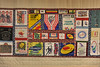 Walt Hester | Trail Gazette<br /> A quilt of cycling t-shirts and jerseys, made by Becky Middleton, hangs in the Estes Valley Public Library on Wednesday. Severl different styles of quilts from different artists is hanging upstairs in the library this month.