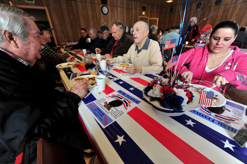 Walt Hester   Trail Gazette<br /> George Peck, center, catches up with fellow veterans at the annual breakfast for Veterans' Day at the American Legion Post 119 in Estes Park on Thursday. Peck served as a dive bomber piolot in the Pacific during WWII.
