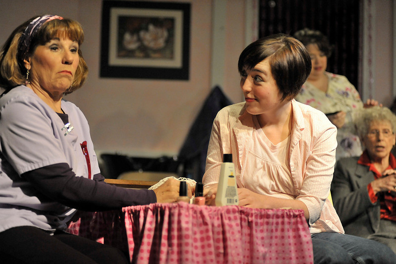 Walt Hester | Trail Gazette<br /> Truvy, Christann Higley, left, reacts to conversations in her Louisiana salon in the play Steel Magnolias. The original off-Broadway play written by Robert Harling, delt with the death of Harling's Sister.