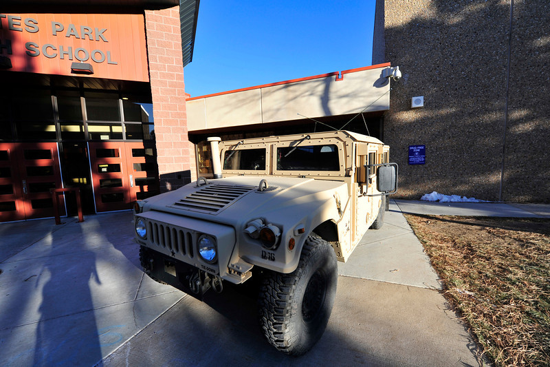 Walt Hester | Trail Gazette<br /> A Humvee awaits its driver in front of the Estes Park High School on Wednesday. Like the fabled 500-pound gorilla, Humvees park pretty much where ever they want.