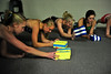 Walt Hester | Trail Gazette<br /> The Estes Park High School Ladycats warm up with core-muscle exercises on Monday. The work helps lock the body's midsection, giving the rest of the body an anchor from which push off.