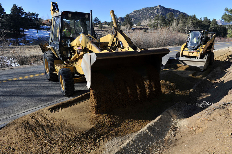 Walt Hester | Trail Gazette<br /> A frontend loader unloades sand as a smaller bobcat smooths out the surface north of Little Valley on Wednesday. The new multi-use trail is slowly inching its way up Fish Creek Road and is expected to connect with the west portion of the trail some time this winter.