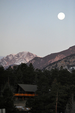Walt Hester | Trail Gazette<br /> A nearly-full moon hangs over a calm Estes Park on Friday morning, belying the weather to follow. Winds in Estes Park reached hurricane force on Saturday night.