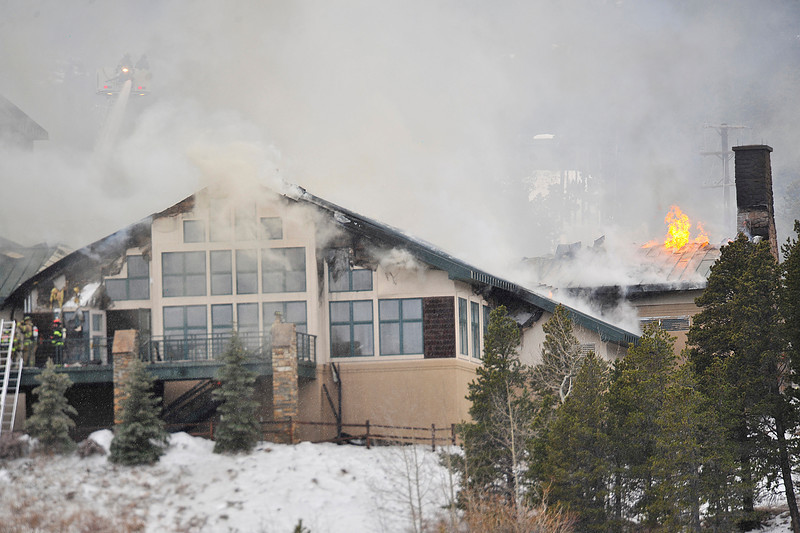 Walt Hester | Trail Gazette<br /> Smoke and flames continue to billow out of the main lodge of the St. Malo Center on Monday afternoon. Bouder County officials reported that no one was injured in the fire.