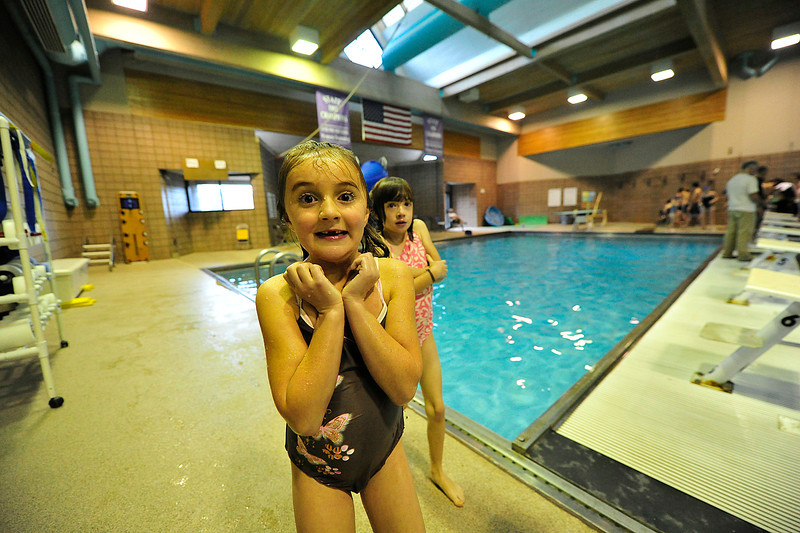 Walt Hester   Trail Gazette<br /> Maya Kiser smiles and shivers during swim practice on Wednesday.