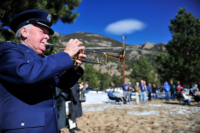 Walt Hester | Trail Gazette<br /> Loren Johnson plays at the Estes Valley Memorial Gardens Veterans' Day ceremony on Friday. The unusually pleasant weather brought out many of Estes Park's veterans.