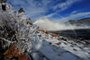 Walt Hester | Trail Gazette<br /> High winds on Saturday blow spray from the Mary's Lake outlet on rocks, snow and vegetation around the south side of the lake. Wind gusts near 75 mile per hour buffetted Estes Park over the weekend.