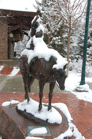 "The statue ""Green Apples"" near the front entrance of the Estes Valley Library is covered by snow from the Nov. 19 storm that moved through the Estes Park area."