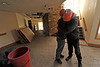 "Walt Hester | Trail Gazette<br /> St. Malo's operations manager Jeff Rivar hugs the center's director, Jose Ambrozic, at the center on Tuesday. Ambrozic lost all of his personal belongings when the center's main lodge caught fire on Nov. 14. ""Sometimes God wants us to travel lighter,"" said Ambrozic."
