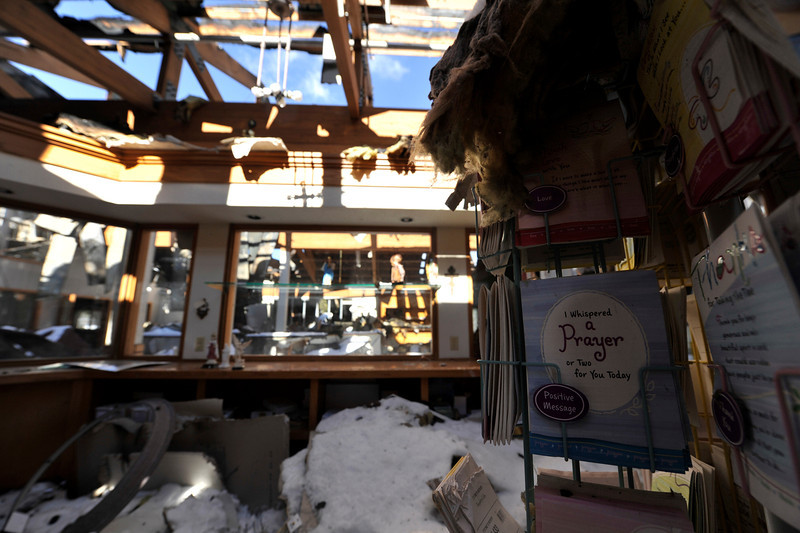 Walt Hester | Trail Gazette<br /> A few greeting cards remain unscathed in the St. Malo Retreat Center's gift shop as sunshine streams through what used to be the roof of the building. The center's mainlodge caught fire, starting in the ceiling, on November 14.