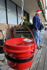 Walt Hester | Trail Gazette<br /> The familiar red bucket of the Salvation Army awaits donations in front of Safeway on Sunday morning. The bell ringers start their annual campaign this week.