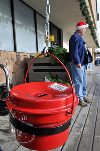 Walt Hester   Trail Gazette The familiar red bucket of the Salvation Army awaits donations in front of Safeway on Sunday morning. The bell ringers start their annual campaign this week.