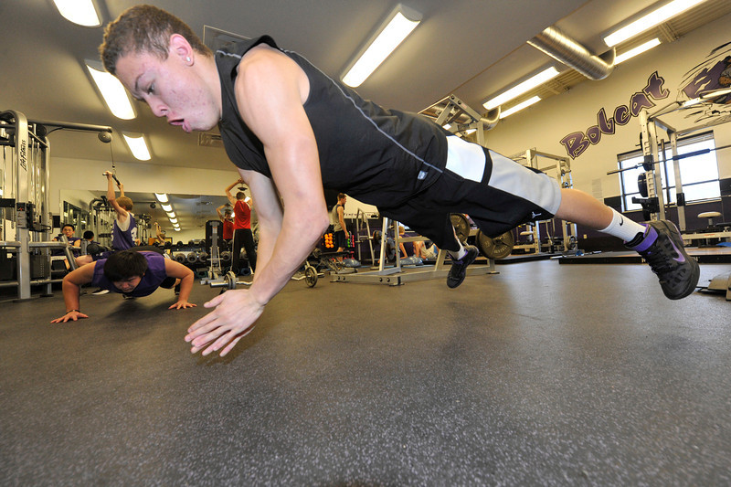 Walt Hester | Trail Gazette<br /> Senior track athlete Kent White performs a difficult variation of a push up at the high school on Tuesday. Year round work for specific spots has become the norm, even in smaller towns and in younger grades.
