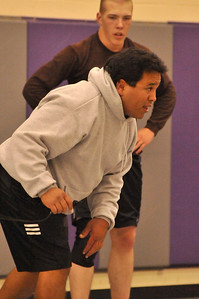 Walt Hester   Trail Gazette Bobcats' wrestling headcoach Josh Flores instructs his small team of talented athletes on Monday. This is Flores second year at the helm of the wrestling team.