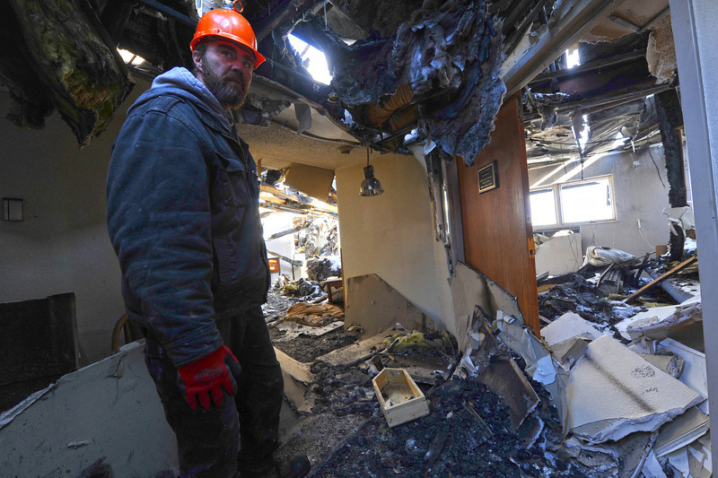 Walt Hester | Trail Gazette<br /> Jeff Rivar, operations manager for the St. Malo Retreat Center tours the third floor of the center's main lodge on Tuesday. The building's chapel, right, housed a morning mass when the building caught fire on November 14.