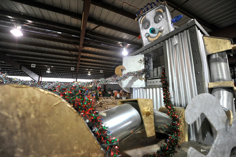 Walt Hester | Trail Gazette<br /> Yule the Christmas Robot smiles before the parade. Many older floats are spruced up for the crowds.